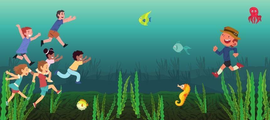 Unterwasser rennen Kinder auf ein anderes Kind zu, sie spielen Herr Fischer